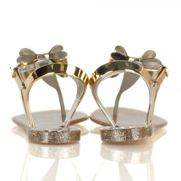 7698ab2439be BCBGeneration Gold Flat Jelly Sandals