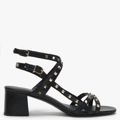8af3ebd5e2 Iman Black Leather Studded Block Heel Sandals